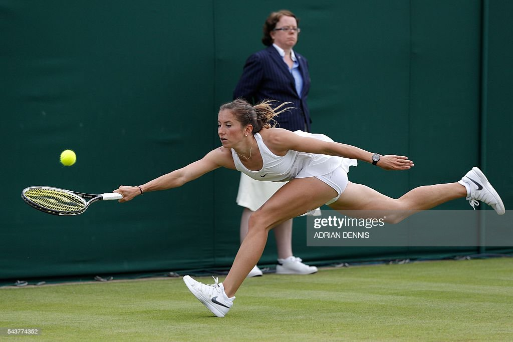 Germany's Annika Beck stretches for a return against Britain's Heather Watson during their women's singles first round match on the fourth day of the 2016 Wimbledon Championships at The All England Lawn Tennis Club in Wimbledon, southwest London, on June 30, 2016. / AFP / ADRIAN