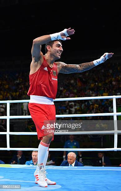 Germany's Artem Harutyunyan celebrates winning against Turkey's Batuhan Gozgec during the Men's Light Welter Quarterfinal 3 match at the Rio 2016...