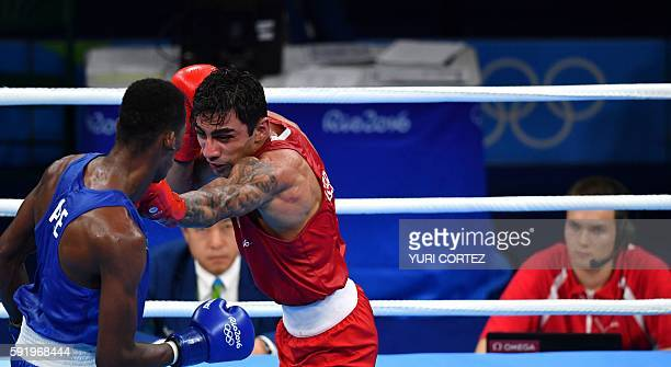 Germany's Artem Harutyunyan fights Azerbaijan's Lorenzo Sotomayor Collazo during the Men's Light Welter Semifinal 2 at the Rio 2016 Olympic Games at...