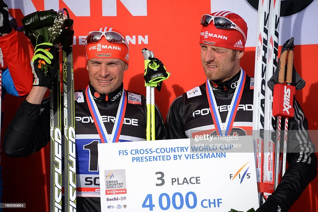 Germany's Axel Teichmann (L) and Tobias Angerer react after 6 x 1,8 km Men's Classic Team Sprint of FIS Cross Country skiing World Cup at Laura Cross Country and Biathlon Center in Russian Black Sea resort of Sochi on February 3, 2013. Russia's Maxim Vylegzhanin and Dmitry Japarov took the first place ahead of Sweden's Teodor Peterson and Emil Joensson and Germany's Axel Teichmann and Tobias Angerer .