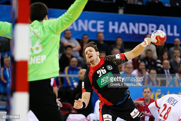 Germany's back Kai Hafner shoots against Croatia's goalkeeper Filip Ivic during the 25th IHF Men's World Championship 2017 Group C handball match...