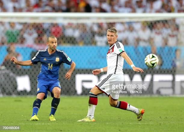Germany's Bastian Schweinsteiger and Argentina's Javier Mascherano battle for the ball