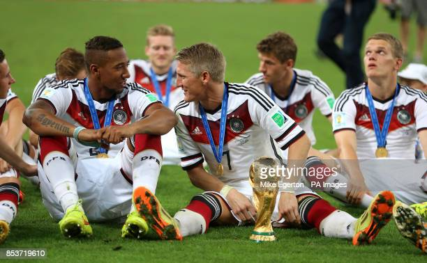 Germany's Bastian Schweinsteiger and Jerome Boateng celebrate victory in the FIFA World Cup Final at the Estadio do Maracana Rio de Janerio Brazil