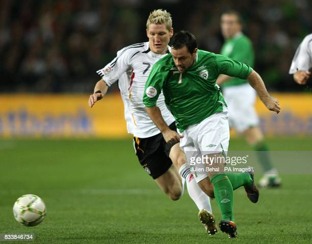 Germany's Bastian Schweinsteiger and Republic Of Ireland's Andy Reid battle for the ball