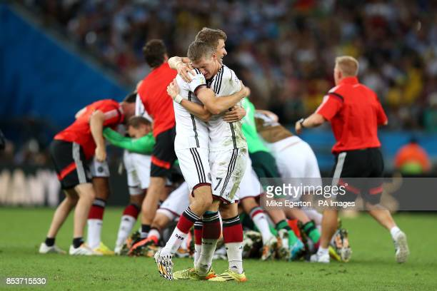 Germany's Bastian Schweinsteiger and Thomas Muller celebrate at the final whistle