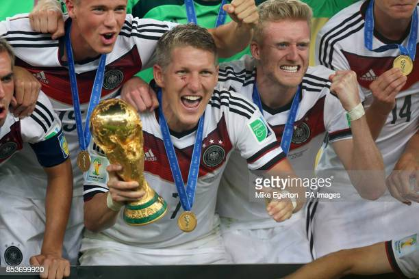 Germany's Bastian Schweinsteiger celebrates victory with teammates and the World Cup trophy after the FIFA World Cup Final at the Estadio do Maracana...