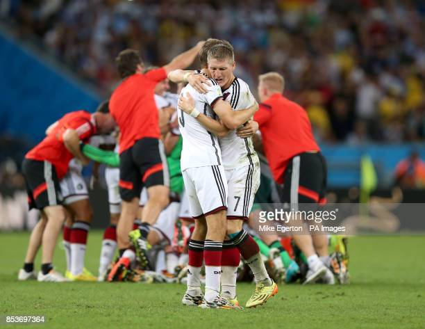 Germany's Bastian Schweinsteiger celebrates with team mate Thomas Muller after winning the FIFA World Cup Final at the Estadio do Maracana Rio de...