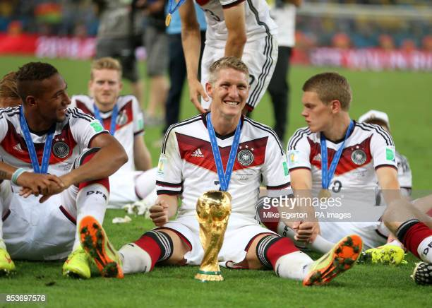 Germany's Bastian Schweinsteiger celebrates with the World Cup trophy after the FIFA World Cup Final at the Estadio do Maracana Rio de Janerio Brazil