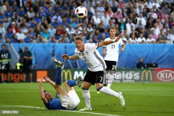 Germany's Bastian Schweinsteiger has a goal ruled out for an infringement after fouling Italy's Mattia De Sciglio