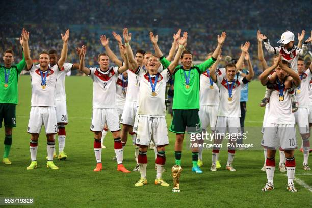 Germany's Bastian Schweinsteiger leads the celebrations after victory in the FIFA World Cup Final