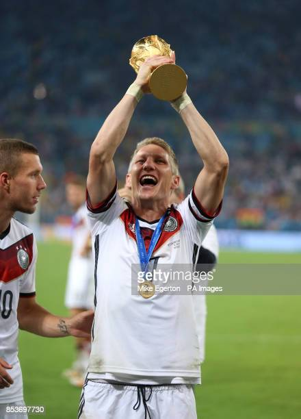 Germany's Bastian Schweinsteiger lifts the World Cup after the FIFA World Cup Final at the Estadio do Maracana Rio de Janerio Brazil