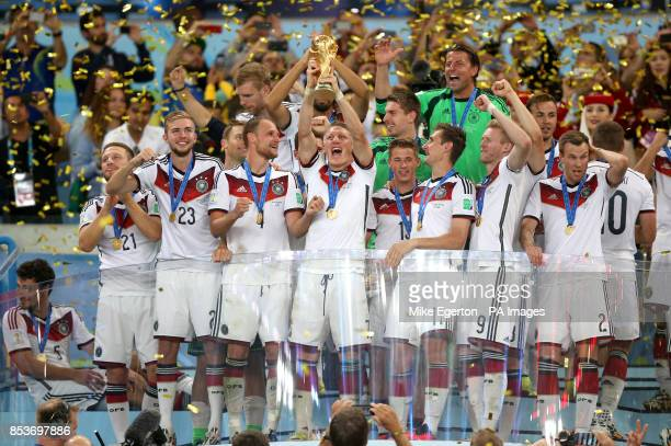 Germany's Bastian Schweinsteiger lifts the World Cup and celebrates victory with teammates after the FIFA World Cup Final at the Estadio do Maracana...