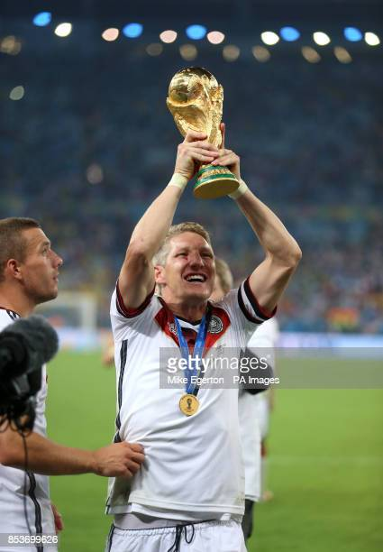 Germany's Bastian Schweinsteiger lifts the World Cup as he celebrates victory in the FIFA World Cup Final at the Estadio do Maracana Rio de Janerio...