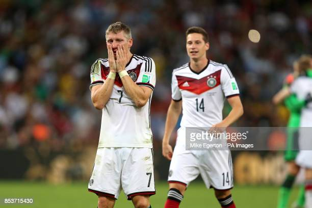Germany's Bastian Schweinsteiger shows his emotions at the final whistle as teammate Julian Draxler looks on