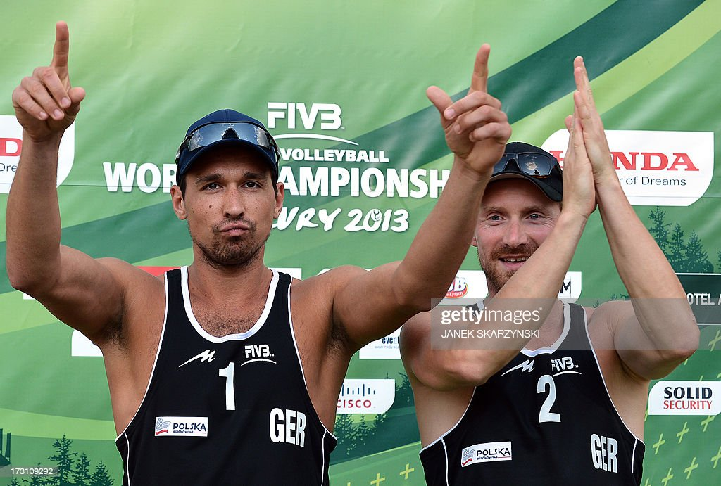 Germany's beach volleyball players Jonathan Erdmann (L) and Kay Matysik cheer after they won the bronze medal after they defeated the Brazilian team Alison Cerutti and Emanuel Rego (both not pictured) during the Beach Volleyball World Championships on July 7, 2013 in Stare Jablonki, Poland.