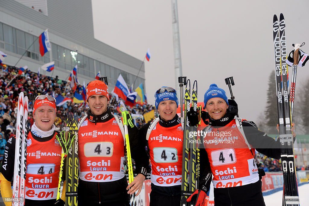 Germany's (L-R) Benedikt Doll, Arnd Peiffer, Andreas Birnbacher and Eric Lesser celebrate their second place after the Men 4x7,5 km Relay during IBU World Cup Biathlon at Laura Cross Country and Biathlon Center in Russian Black Sea resort of Sochi on March 10, 2013. Russia's team took the first place ahead of Germany and Czech Republic.