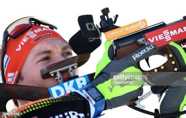 Germany's Benedikt Doll shoots during the Men's 125 km pursuit race during the 2017 IBU Biathlon World Championships in Hochfilzen on February 12...