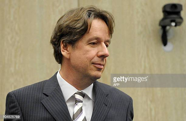 Germany's bestknown television weatherman Swiss Joerg Kachelmann arrives for the start of a trial day at court in Mannheim southwestern Germany on...