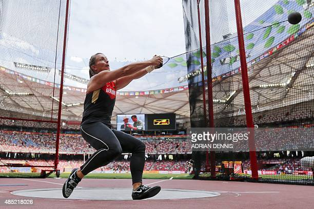 Germany's Betty Heidler competes in the qualifying round of the women's hammer throw athletics event at the 2015 IAAF World Championships at the...