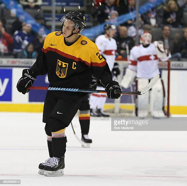 TORONTO JANUARY 3 Germany's captain Dominik Kahun looks defeated and dejected as the game ends 2015 IIHF World Junior Championship hockey between...