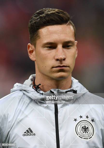 Germany's captain Julian Draxler listens to the national anthems ahead of the 2017 Confederations Cup group B football match between Germany and...