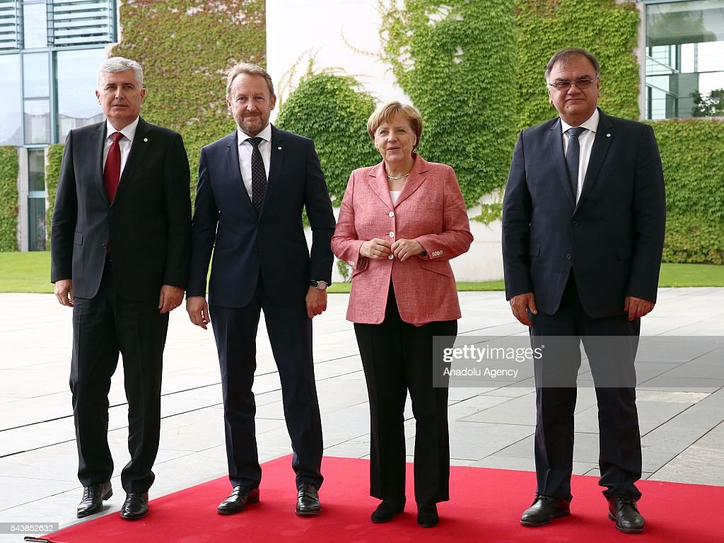 Germany's Chancellor Angela Merkel (R 2) and Bosnian members of the Tripartite Presidency of Bosnia and Herzegovina Dragan Covic (L), Bakir Izetbegovic (L 2) and Mladen Ivanic (R) pose for photographer during an official welcoming ceremony at Chancellery on June 30, 2016 in Berlin, Germany.