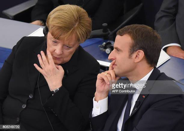 Germany's Chancellor Angela Merkel and French President Emmanuel Macron attend a ceremony for late German Chancellor Helmut Kohl on July 1 2017 at...