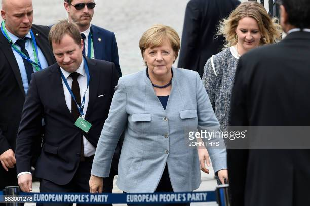 Germany's Chancellor Angela Merkel arrives at a meeting of the European Peoples Party in Brussels on October 19 2017 on the side of the first day of...