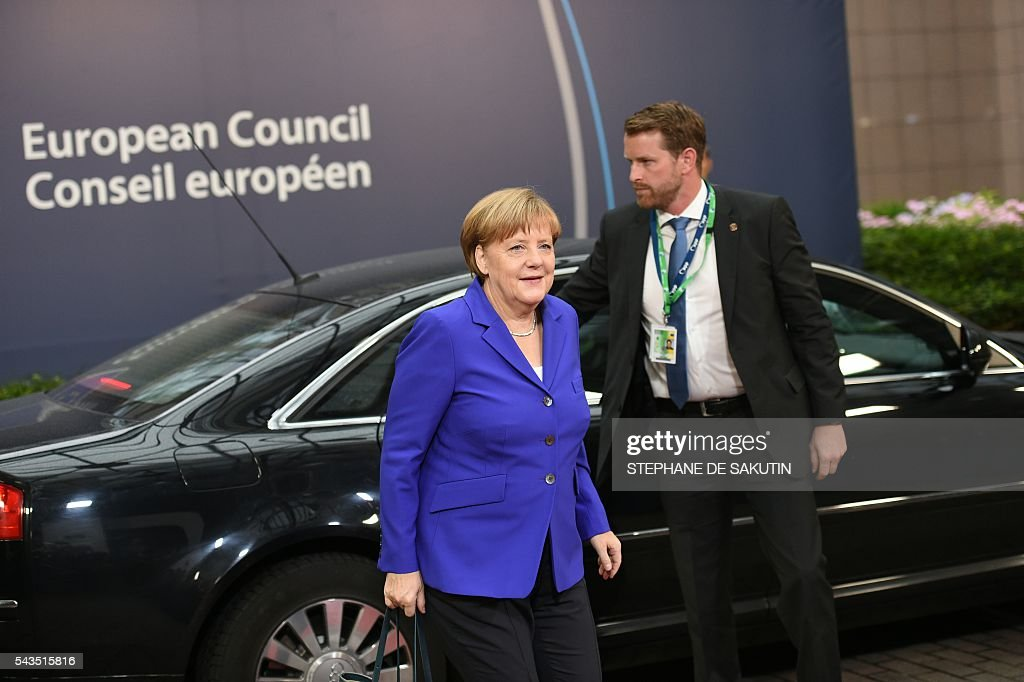 Germany's Chancellor Angela Merkel arrives before an EU summit meeting on June 29, 2016 at the European Union headquarters in Brussels. European Union leaders will assess the damage from Britain's decision to leave the bloc and try to prevent further disintegration, as they meet for the first time without a British representative on June 29, 2016. And as the shockwaves reverberate around British politics, Scottish First Minister Nicola Sturgeon is also expected in Brussels 'utterly determined' to keep her pro-EU country in the club despite the Brexit vote. SAKUTIN