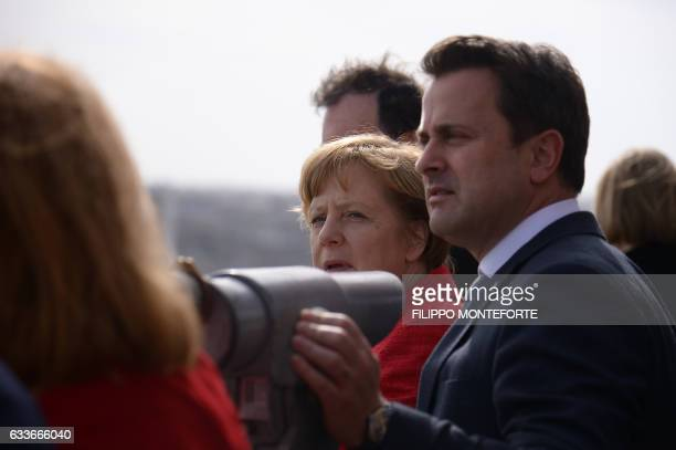 Germany's Chancellor Angela Merkel chats with Luxembourg's Prime Minister Xavier Bettel during an European Union summit on February 3 2017 in...