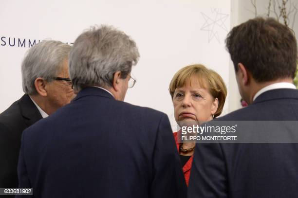 Germany's Chancellor Angela Merkel chats with President of the European Commission JeanClaude Juncker Italy's prime Minister Paolo Gentiloni and...