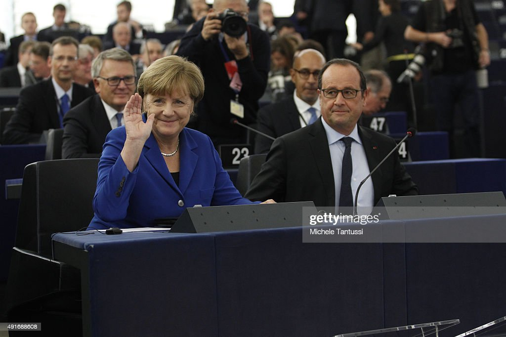 Germany's Chancellor Angela Merkel L and French president Francois Hollande Smile ahead of their joint speech to the members of the European...