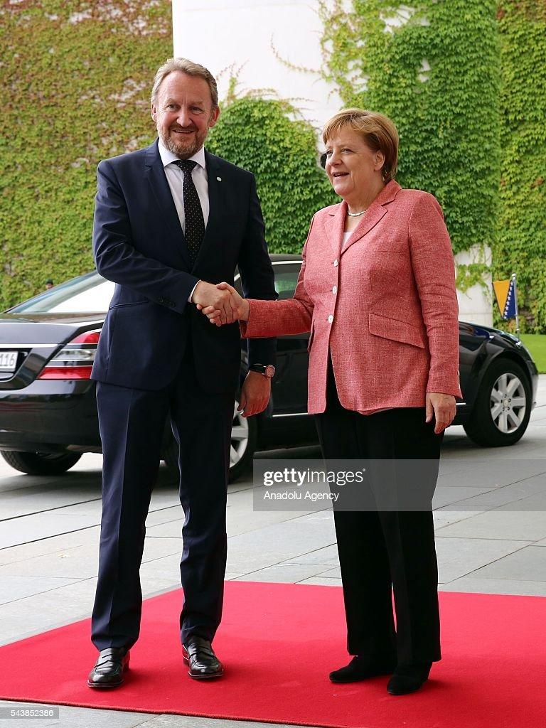 Germany's Chancellor Angela Merkel welcomes Bakir Izetbegovic (L), Bosnian member of the Tripartite Presidency of Bosnia and Herzegovina at Chancellery on June 30, 2016 in Berlin, Germany.