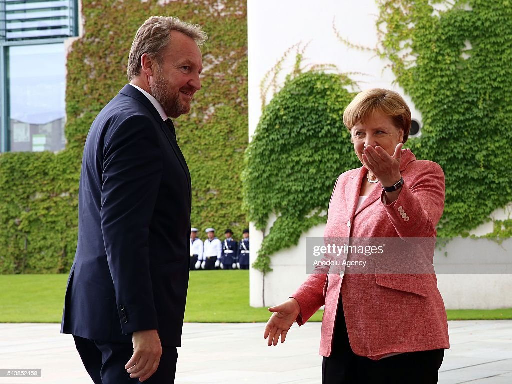 Germany's Chancellor Angela Merkel welcomes Bakir Izetbegovic (L), Bosnian member of the Tripartite Presidency of Bosnia and Herzegovina at Chancellery on June 30, 2016 in Berlin, Germany.