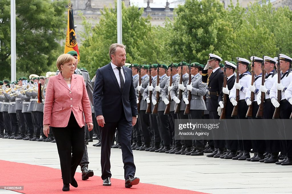 Germany's Chancellor Angela Merkel welcomes Bakir Izetbegovic (L), Bosnian member of the Tripartite Presidency of Bosnia and Herzegovina with an official welcoming ceremony at Chancellery on June 30, 2016 in Berlin, Germany.