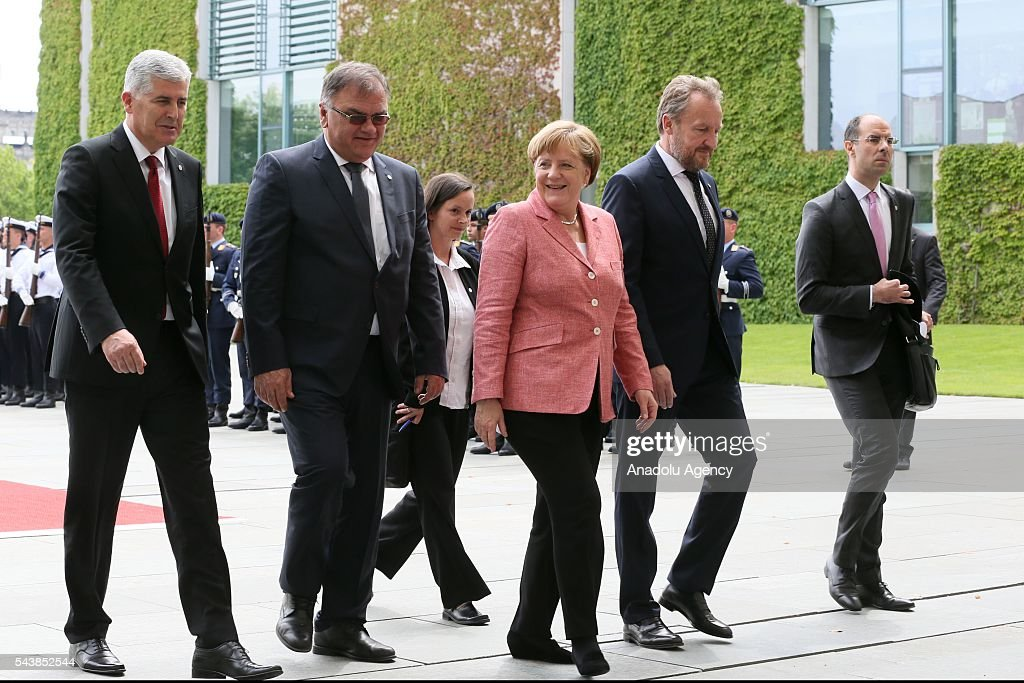 Germany's Chancellor Angela Merkel (R 3) welcomes Bosnian members of the Tripartite Presidency of Bosnia and Herzegovina Dragan Covic (L), Mladen Ivanic (L 2) and Bakir Izetbegovic (R2) at an official welcoming ceremony at Chancellery on June 30, 2016 in Berlin, Germany.