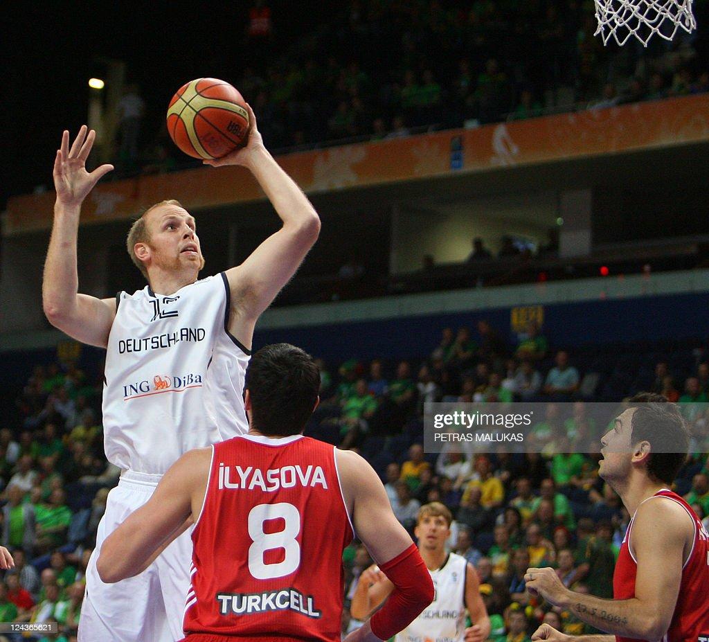 Germany s Chris Kaman L vies with Turk