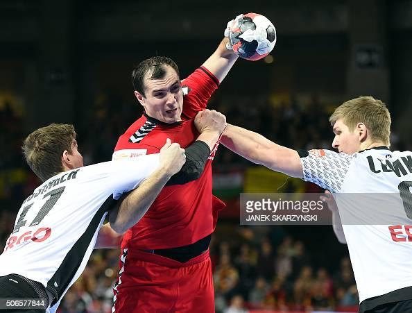 TOPSHOT Germany's Christian Dissinger and Finn Lemke challenge Russia's Sergiei Shelmenko during the Men's 2016 EHF European Handball Championships...