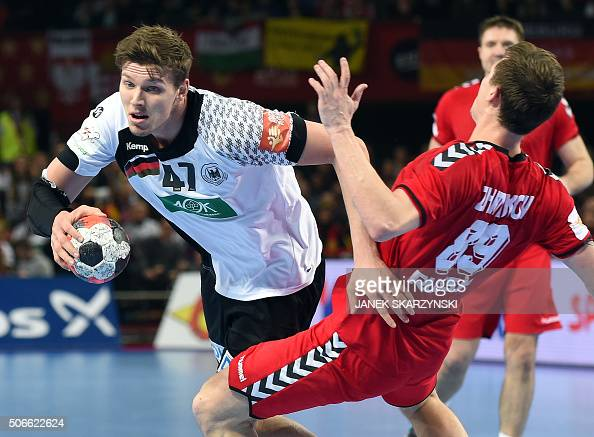 Germany's Christian Dissinger challenges Russia's Dmitrii Zhitnikov during the Men's 2016 EHF European Handball Championships between Germany and...