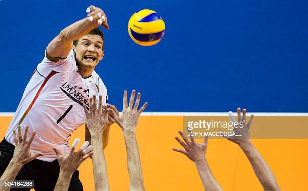 TOPSHOT Germany's Christian Fromm spikes the ball during the semifinal match Germany vs Russia of the 2016 Men's Volleyball Olympic Qualification...