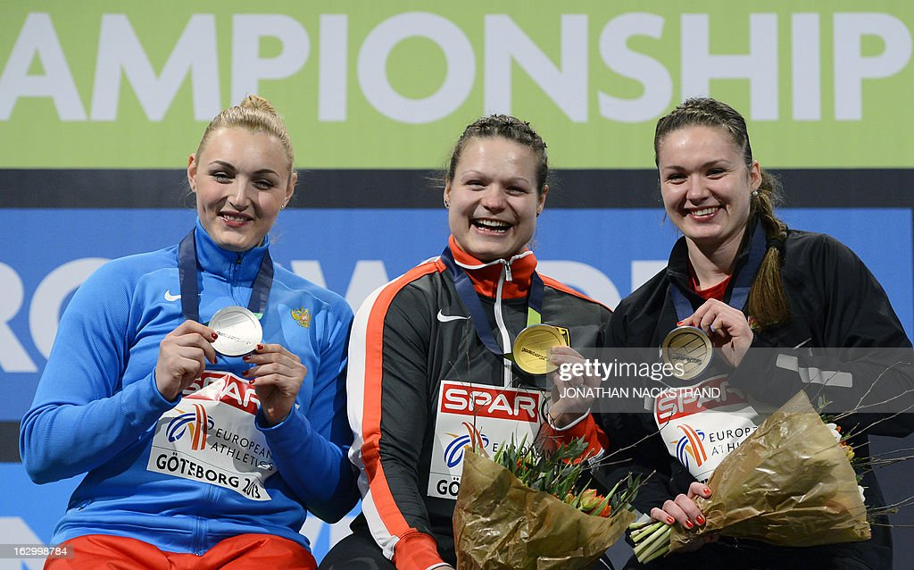 Germany's Christina Schwanitz (C) celebrates winning the Women's Shot Put final event on the podium with 2nd place Russia's Yevgeniya Kolodko (L) and 3rd place Belarus' Alena Kopets at the European Indoor athletics Championships in Gothenburg, Sweden, on March 3, 2013.