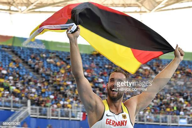 Germany's Christoph Harting celebrates winning the Men's Discus Throw Final during the athletics event at the Rio 2016 Olympic Games at the Olympic...