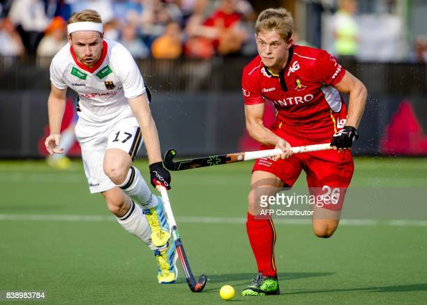 Germany's Christopher Ruhr fights for the ball with Belgium's Victor Wegnez during the men's hockey semifinal match Germany v Belgium at The Rabo...
