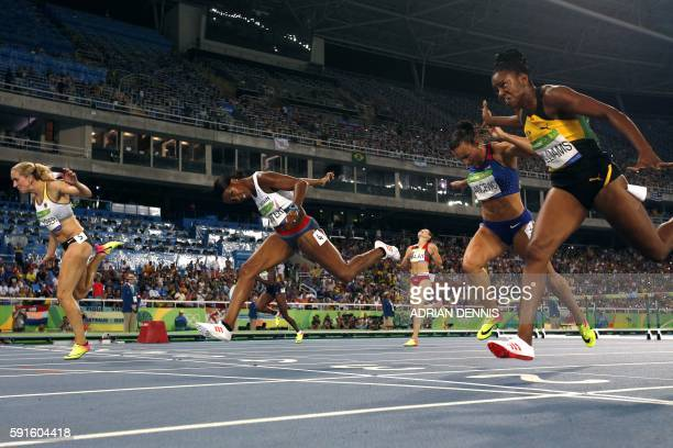 Germany's Cindy Roleder Britain's Tiffany Porter Belarus' Alina Talay Croatia's Andrea Ivancevic and Jamaica's Shermaine Williams compete in the...
