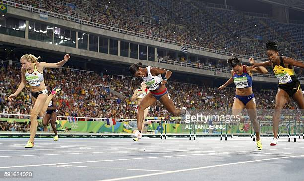 Germany's Cindy Roleder Britain's Tiffany Porter Croatia's Andrea Ivancevic and Jamaica's Shermaine Williams compete in the Women's 100m Hurdles...
