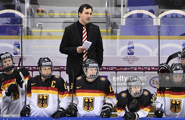 Germany's coach Benjamin Hinterstocker looks on during the IIHF Ice Hockey Women's World Championship group B match between Germany and Sweden at...