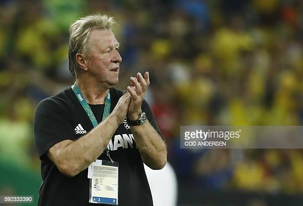 Germany's coach Horst Hrubesch applauds his players from the touchline during the Rio 2016 Olympic Games men's football gold medal match between...