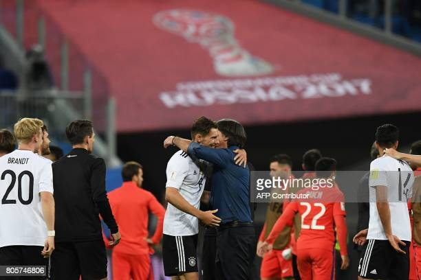 Germany's coach Joachim Loew hugs Germany's midfielder Leon Goretzka after Germany beat Chile 10 to win the 2017 Confederations Cup final football...