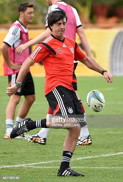 Germany's coach Joachim Loew kicks a rugby ball during a training session in Santo Andre on June 23 during the 2014 FIFA World Cup football...