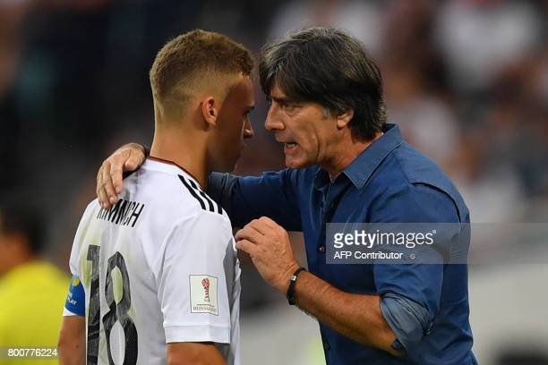 Germany's coach Joachim Loew speaks to Germany's defender Joshua Kimmich during the 2017 FIFA Confederations Cup group B football match between...